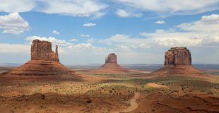 Panorama with West Mitten Butte, East Mitten Butte und Merrick Butte in Monument Valley Royalty Free Stock Images