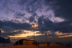 Western District Public Cargo Pier, Hong Kong. Panorama of Western District Public Cargo Pier, Hong Kong. People are relaxing with the sunset royalty free stock image
