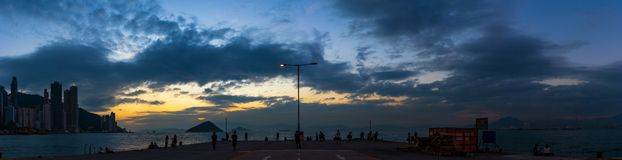 Western District Public Cargo Pier, Hong Kong. Panorama of Western District Public Cargo Pier, Hong Kong. People are relaxing with the sunset stock photography