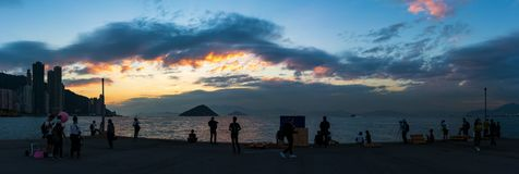 Western District Public Cargo Pier, Hong Kong. Panorama of Western District Public Cargo Pier, Hong Kong. People are relaxing with the sunset stock photos
