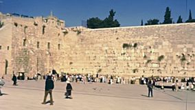 Western Wall Plaza. Panorama of the Western Wall Plaza in old city of Jerusalem with people. Historic restored footage on 1980s in Israel stock video