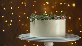 Panorama of cake with rosemary and sugar cranberries. Panorama of white cake decorated with a wreath of rosemary and sugar cranberries stock video