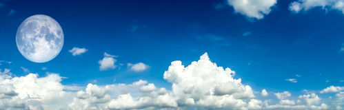 Panorama  of White Cloud blue sky. Full moon Stock Photos