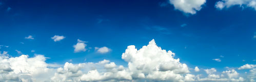 Panorama  of White Cloud blue sky. Moving by wind in summer Royalty Free Stock Photo