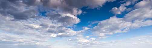 Panorama of the white fluffy clouds Stock Images