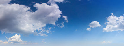 Panorama of the white fluffy clouds Stock Image