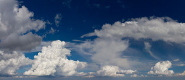 Panorama of the white fluffy clouds Royalty Free Stock Image