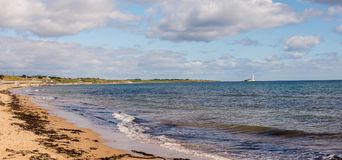 Panorama of Whitley Bay beach with a lighthouse on the island, E. Ngland, Great Britain Stock Photos