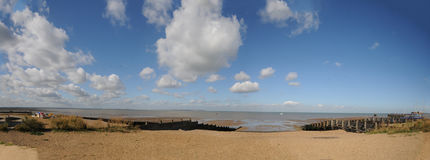 Panorama of Whitstable beach. A scene of the beach at Whitstable in Kent Royalty Free Stock Photo