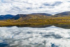 Panorama of wild forest lake in autumn season, Russia royalty free stock photo