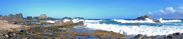Panorama from the wild north east coast on Aruba island. In the Caribbean Royalty Free Stock Photo