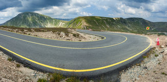 Panorama of winding asphalt highway at sunny day Royalty Free Stock Photo