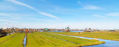 Panorama with windmill in Zaanse Schans, traditional village, Netherlands, North Holland Royalty Free Stock Photo
