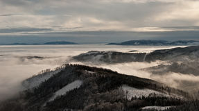 Panorama of winter Beskids mountains with misty Royalty Free Stock Photo