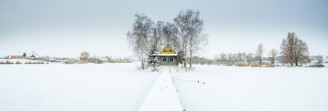 Panorama with winter day and farm house Stock Photography