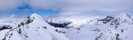 Panorama winter mountain landscape with peaks and the lakes near St. Moritz in the background stock photo