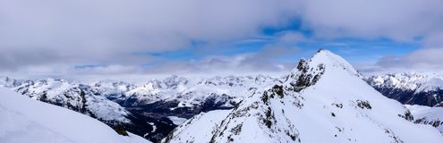 Panorama winter mountain landscape with peaks and the lakes near St. Moritz in the background stock image