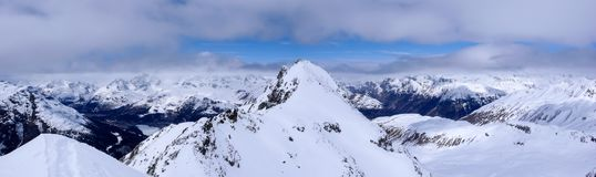 Panorama winter mountain landscape with peaks and the lakes near St. Moritz in the background stock images