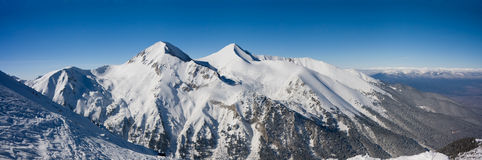 Panorama of winter mountains in Bansko, Bulgaria Royalty Free Stock Photo