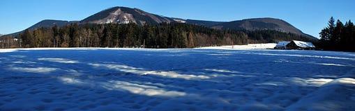Panorama of winter mountains. Panorama of Ondrejnik mountain range near Frydlant nad Ostravici city during nice winter day Royalty Free Stock Image