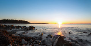 Panorama of winter sunrise at the ocean beach Royalty Free Stock Images