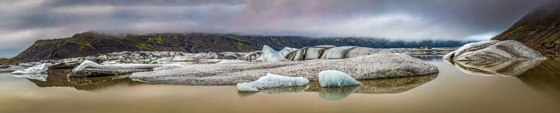 Panorama of wonderful glacier and cold lake in Iceland Stock Images