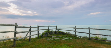 Panorama of a wooden fence on ocean shore in the morning Stock Images