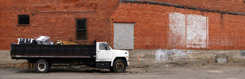 Panorama of Work Truck and Brick Wall Royalty Free Stock Photography