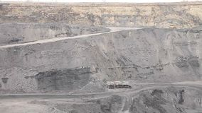 Panorama of a working coal open pit (rigs and trucks). Panorama of a working coal open pit stock video footage