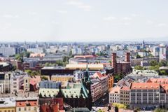 Panorama of Wroclaw, tilt-shift effect. On the background of blue sky royalty free stock photos