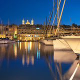 Panorama wth sailing boats on Senglea marina in Grand Bay, Valet. Ta, Malta, on a quiet evening. This image is toned Stock Photos