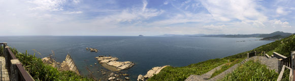 Panorama of Yehliu coastal geologic formations in summer Stock Photos