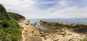 Panorama of Yehliu geologic formations in summer Stock Photography