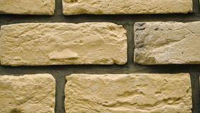 Panorama of yellow decorative brick for home. Brickwork background. Figure block. Clear place for your isolated text pattern. Empty space for your title copy stock video footage