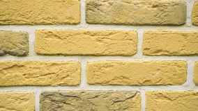 Panorama of yellow decorative brick for home. Brickwork background. Figure block. Clear place for your isolated text pattern. Empty space for your title copy stock video