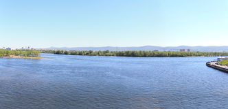 Panorama of the Yenisei with footbridge. Krasnoyarsk Royalty Free Stock Photos