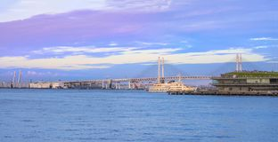 Panorama of Yokohama Bay Bridge and ÅŒsanbashi Pier in the Minato Mirai district of Yokohama with a cruise ship under the sunset. Sky stock photo