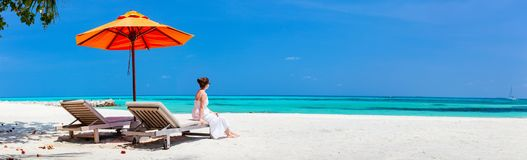 Young woman relaxing at beach royalty free stock image