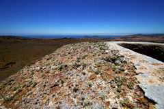 Panoramas  lanzarote  spain the old   sentry tower and slot in t Royalty Free Stock Images