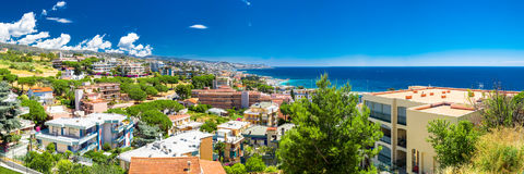 Panoramatic view of Sanremo city on Italian Riviera. Panoramatic view to Sanremo city with beaches and azure clear water, Mediterranean Coast, Italian riviera Royalty Free Stock Image