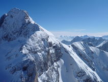 Panoramatic view of snow covered high mountains Stock Photos