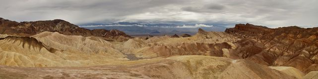Panoramatic view of Zabriskie point in Death Valley California. Desert in Death Valley, Californie. Beautifull view with clouds after rain Royalty Free Stock Photos