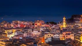 Panoramautsikt av citylightsna av den Korfu staden på natten Fotografering för Bildbyråer