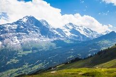 Panoramautsikt av Eiger, Monch och Jungfrau Arkivbilder