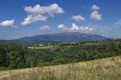 Panoramautsikt av för- sommar med byar Plana Arkivbild