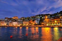 Panorame da noite de Porto Santo Stefano Fotografia de Stock Royalty Free