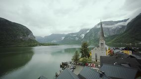Panorami view at the lake of the Hallstatt surrounded by mountains in clouds. Austria nature. midle shot stock video
