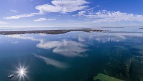 Panoramic aerial cloud seascape, in Ria Formosa wetlands, Algarve. Panoramic aerial cloud seascape, in Ria Formosa wetlands natural park, over Cavacos beach Stock Photography