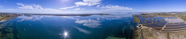 Panoramic aerial cloud seascape, in Ria Formosa wetlands, Algarve. Panoramic aerial cloud seascape, in Ria Formosa wetlands natural park, over Cavacos beach Royalty Free Stock Image