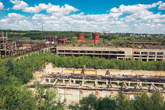 Panoramic aerial view from above to Soviet abandoned factory in Efremov, Russia. Abandoned buildings, workshops overgrown with green forest Royalty Free Stock Photography